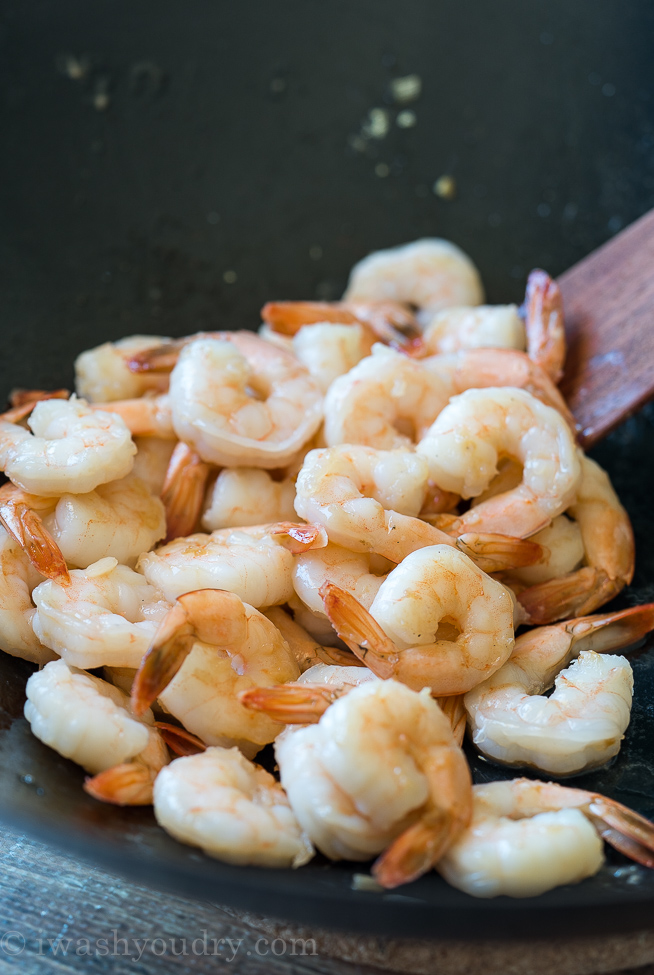 Cook the shrimp in a little bit of sesame oil before adding to the super easy fried rice to make it a full meal!