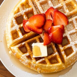A plate of food, with Waffle