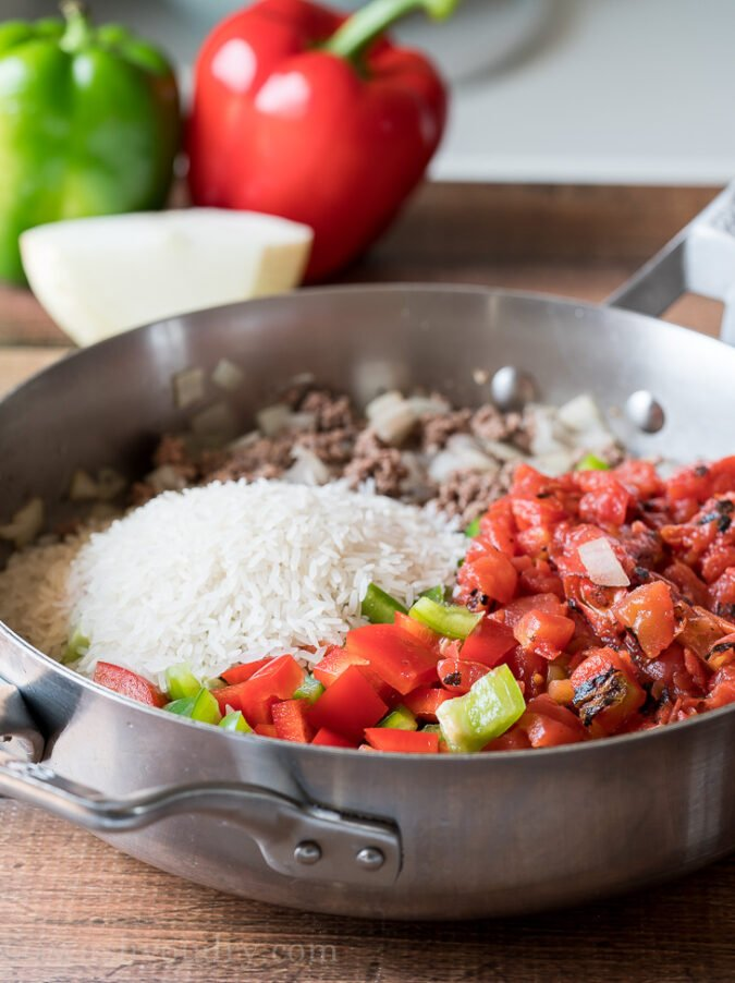 Brown hamburger in a skillet with some onion, garlic and then toss in diced bell peppers and tomatoes.