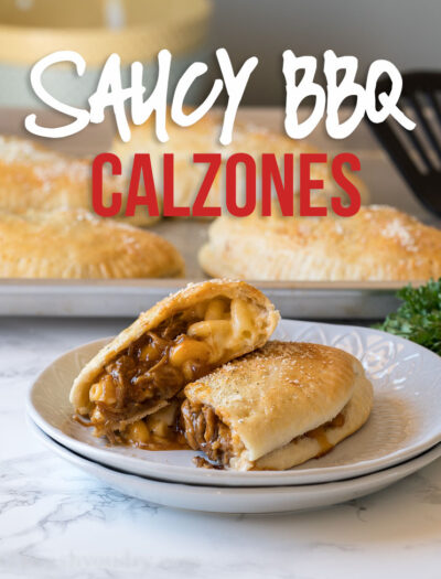 YUM! These Cheesy BBQ Pork Calzones are stuffed with extra cheesy macaroni and cheese, saucy shredded pork and baked until golden brown.