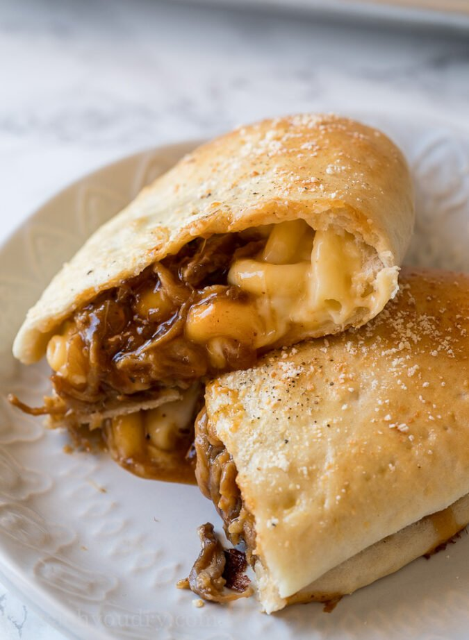 OMG! These Cheesy BBQ Pork Calzones are everything you love about good old barbecue wrapped up in a warm and crispy calzone!