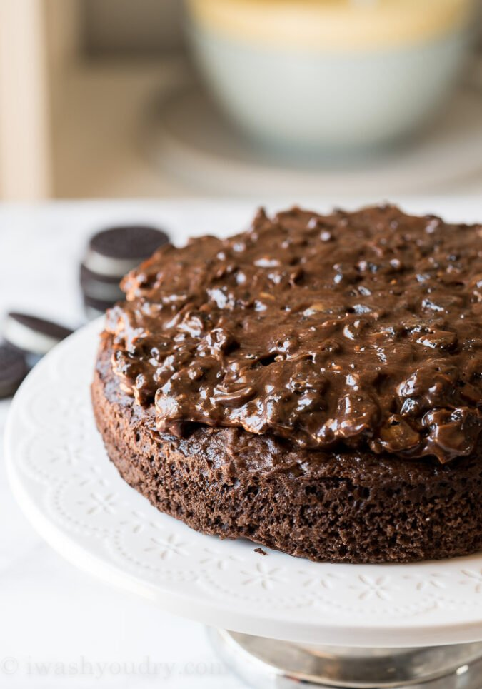 Spread the hot fudge cookie mixture on top of your prepared cake layer.