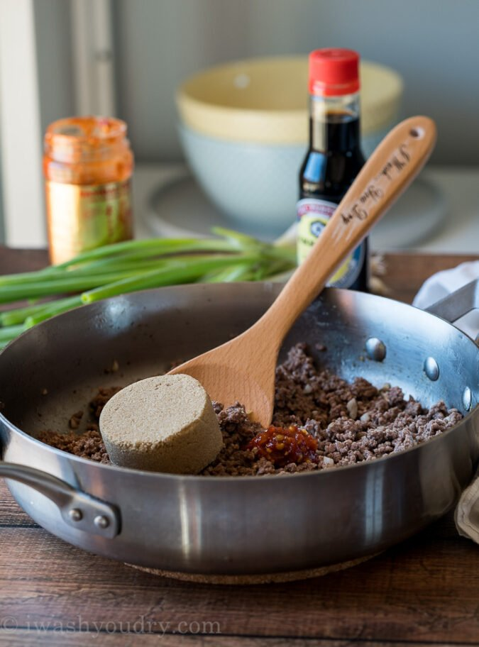 Start by browning your lean ground beef in a skillet with ginger and garlic. Drain any excess fat and then add in brown sugar, sesame oil, soy sauce and chili garlic sauce to create the BEST Korean Ground Beef!