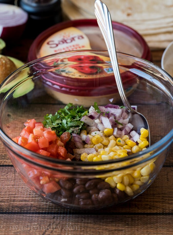 Start by mixing up a simple black bean salsa that consists of corn, black beans, tomato, onion and cilantro.