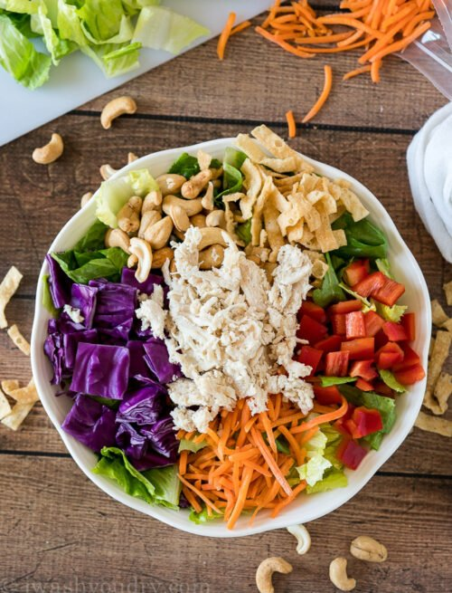 By placing the colorful ingredients around the bowl it makes it more attractive and fun to eat! Your kids will LOVE this Asian Chicken Salad!