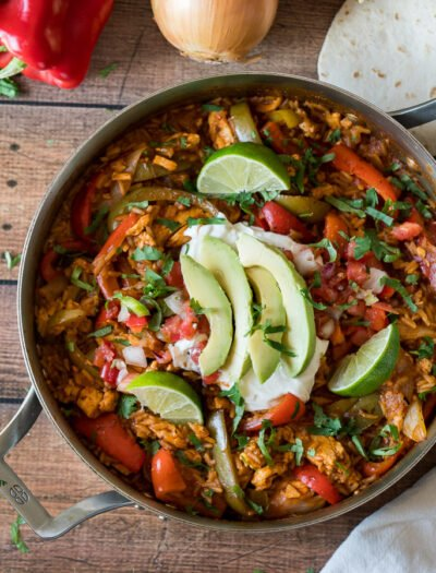 Serve this super easy Chicken Fajita Rice Skillet in tortillas, over lettuce or wrapped up in a burrito. Either way is mega delicious!