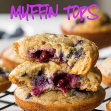 A close up of stacked muffin tops, with blueberries in them