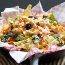 A close up of plate of Spicy California roll Sushi Nachos