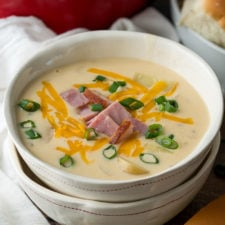 YUM! This super easy Ham and Potato Soup recipe is ready in less than 30 minutes for an easy weeknight dinner!