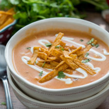 A bowl of soup, with Chicken and Enchilada