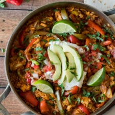 A bowl of food on a table, with Chicken and Fajita