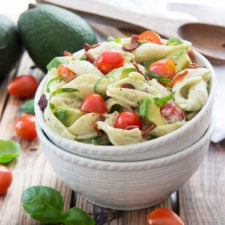 A bowl of salad, with Avocado and Pasta