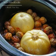 A crockpot with meatballs with squash