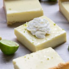 Key Lime Pie Cheesecake Bars displayed on a marble surface