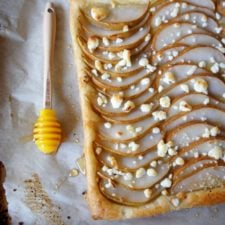 A close up of Pear, Goat Cheese and Honey Tart on a pan