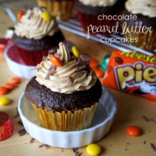 Chocolate cupcakes with Reese's Pieces on top of the frosting