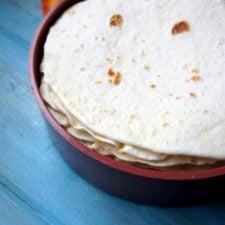 A close up of tortillas in a tortilla warmer