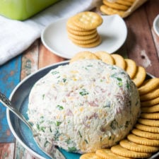 A plate with a cream cheese ball and crackers