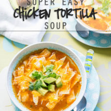 A bowl of food on a plate, with chicken tortilla soup topped with avocado
