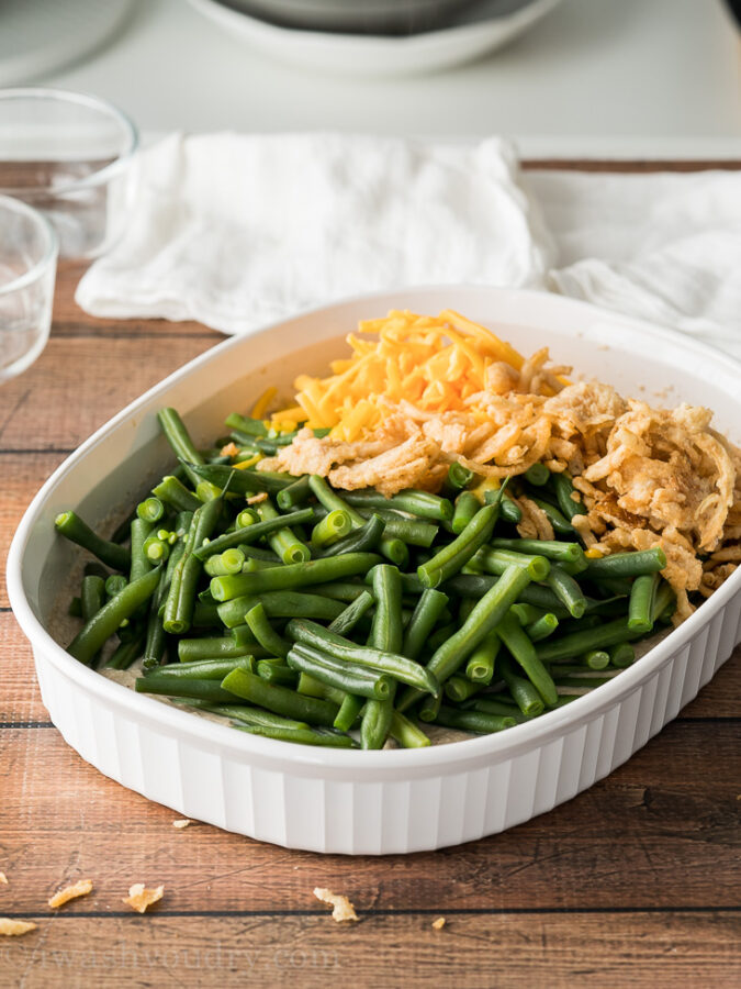 Whisk together the creamy base of your green bean casserole directly in your casserole dish, then stir in the green beans, onions and cheese!