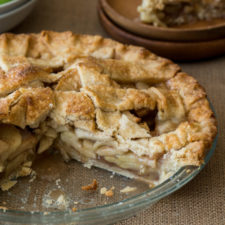 A pan of food on a table, with Apple and Pie