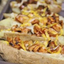 A close up look of Loaded BBQ Potato Skins on a pan