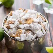 A close up of a bowl of white powdered covered cereal squares