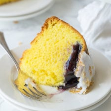 A piece of lemon cake on a plate, with Blueberry