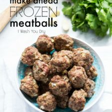A bowl of cooked meatballs on a table