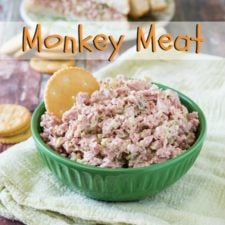 A bowl of monkey meat with a chip in it