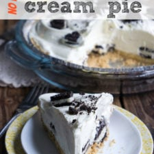 A slice of banana Oreo Cream Pie on a plate next to a full pie with a slice removed