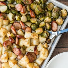 Pan of meat, potatoes and vegetables on a table