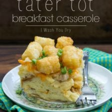 A plate on a table displaying a slice of Egg and Cheese Tater Tot Breakfast Casserole