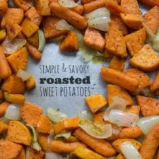 A pan of roasted sweet potatoes, carrots and onions