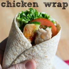 A close up of a Chicken Wrap with veggies