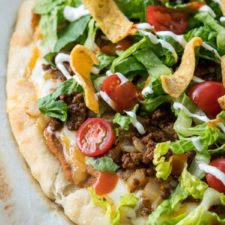 A close up of food, with Pizza and Taco