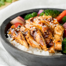 A bowl of food with broccoli, Teriyaki Chicken and rice