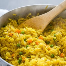 A close up of a pan of rice and vegetables