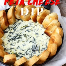 A tray of food, with spinach cheese dip in the middle surrounded by bread slices