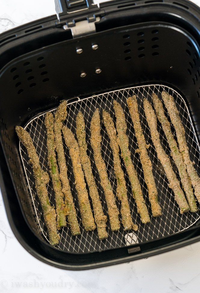 You'll want to make sure your asparagus is in an even layer in the air fryer, leaving just enough room between the spears so they don't touch.
