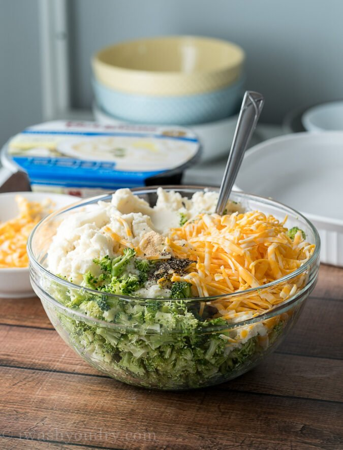 Mix together broccoli, cheese, mashed potatoes and some seasonings to make this super simple mashed potato casserole!