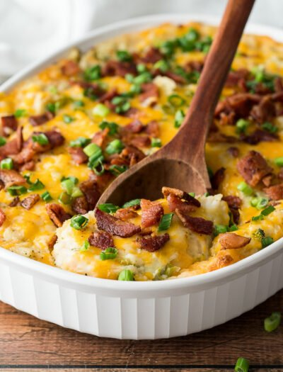 Top the mashed potato casserole with more cheese, crumbled bacon and green onions before baking again. Everyone will love this super easy side dish recipe!