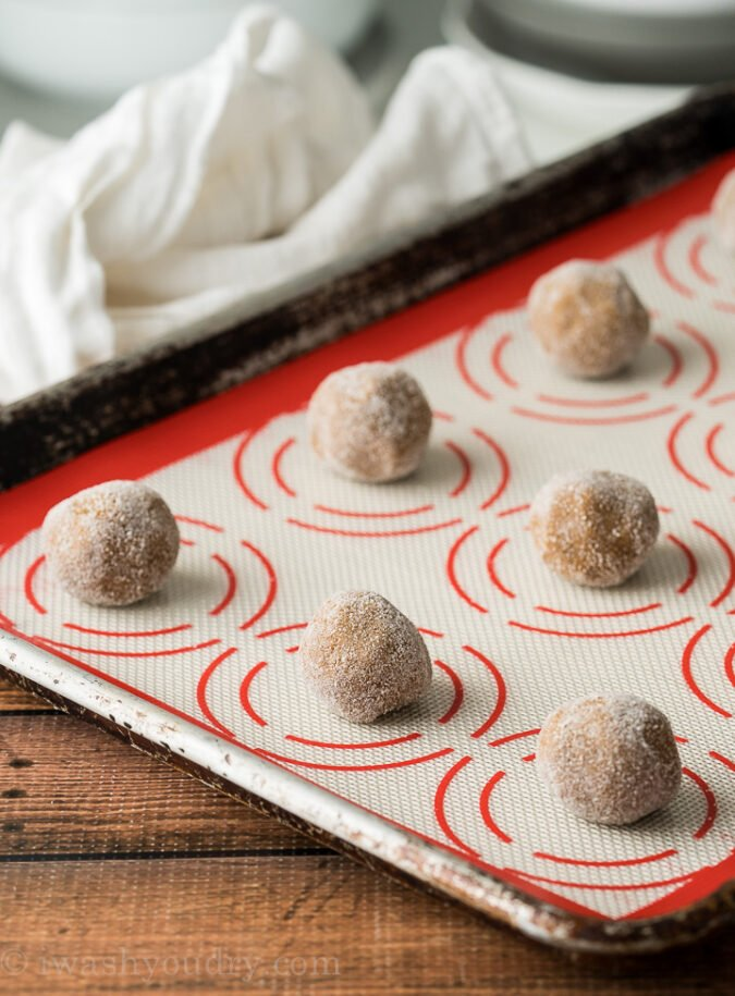 Arrange the molasses ginger cookies about 2 inches apart on a lined baking sheet.