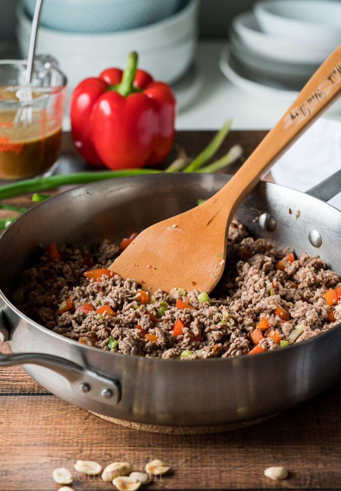 To make this super easy Ground Kung Pao Beef start by browning some hamburger in a skillet with diced bell pepper and onions.