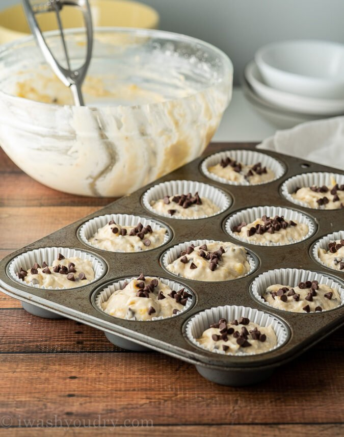 Scoop your super easy muffin batter into prepared muffin cups and bake until golden brown