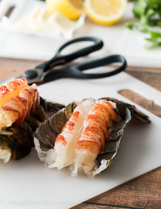 Gently peel back the lobster tail shell to reveal the meat.