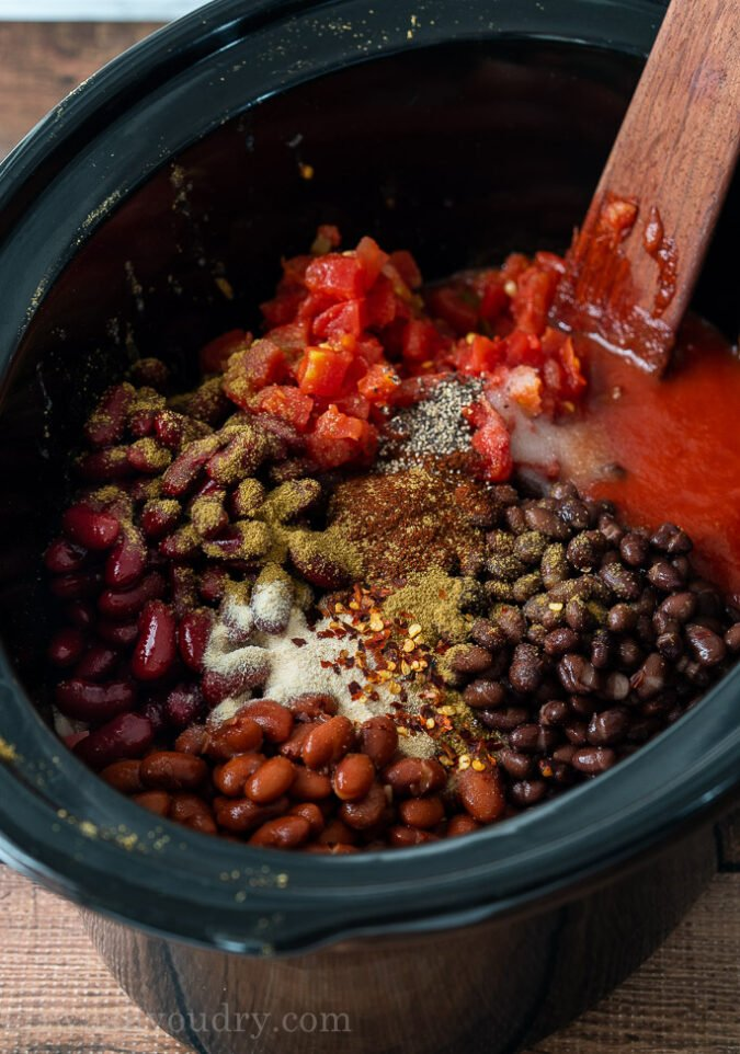 Toss all your Chili Ingredients into the slow cooker, give it a good stir and let simmer all day.