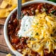 A plate of chili on a table