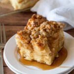 YUM! This super easy French Toast Casserole recipe is soaked overnight in an egg mixture, topped with a brown sugar crumble, then baked to perfection!