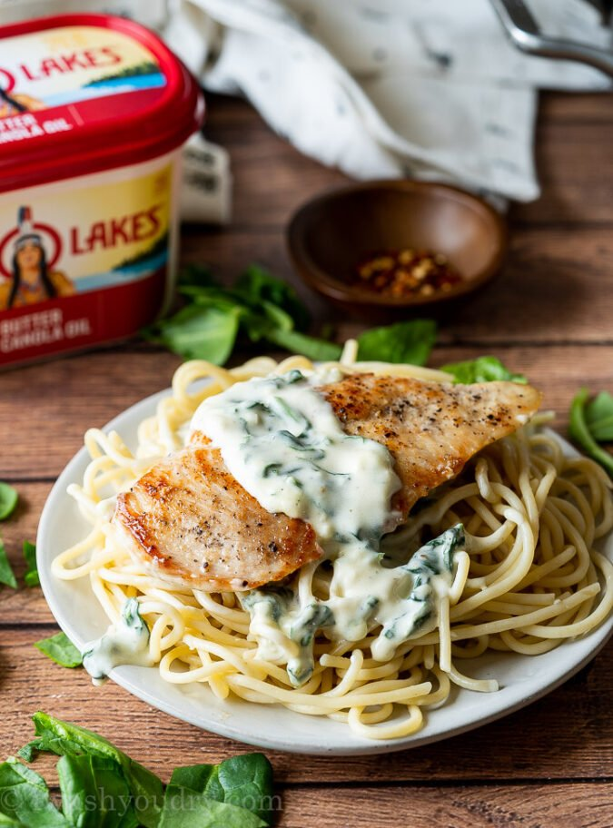 My family really LOVES this super easy chicken recipe! Creamy Garlic Parmesan Chicken with wilted spinach! YUM!